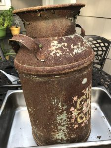 Before Evapo-Rust removed the rust on old milk container